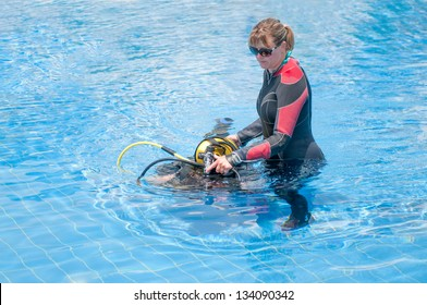 Beautiful young female learning to scuba dive