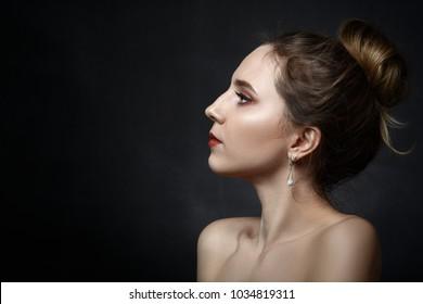 beautiful young female profile on black background