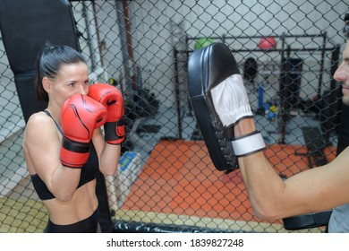 beautiful young female pugilist throws a punch