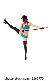 Beautiful young female stage dancer in blue lingerie and a bowler hat doing a leg kick