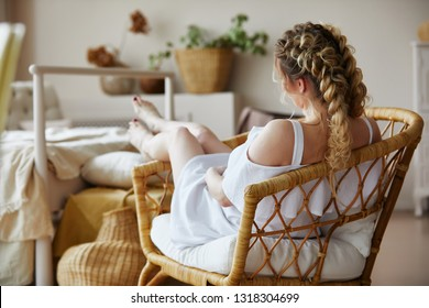 Beautiful young female in white dress sit on vogue straw chair