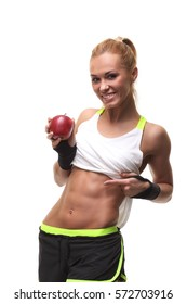 Beautiful young fitness woman happy smiling holding apple