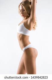 Beautiful young fitness woman with a perfect body.
