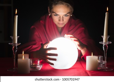Beautiful Young Fortuneteller Holding Hands Around A Glowing Ball