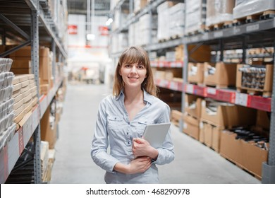 beautiful young furniture store worker stock taking