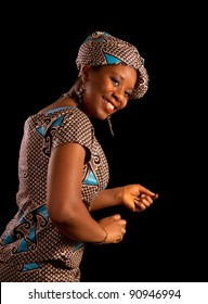 Beautiful young Ghanese african woman showing a dance in her traditional national costume