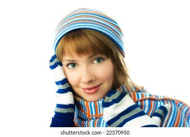 beautiful young ginger woman wearing a scarf, mittens and warm hat  isolated against white background