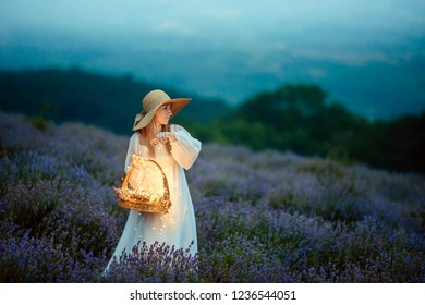 A beautiful young girl admires the magical lavender that shines with brilliant lights.