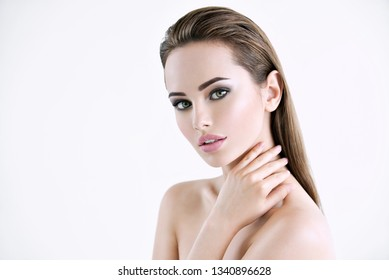 Beautiful young girl with beauty face  - isolated on white.  Skin care concept.