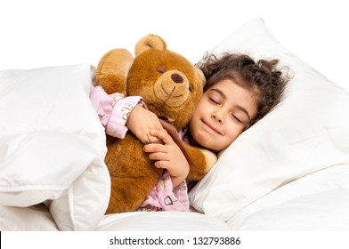 Beautiful young girl in bed with teddy bear