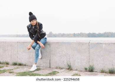 Beautiful young girl in black beanie. Outdoor lifestyle portrait of woman