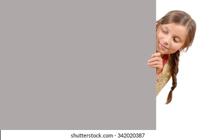 a beautiful young girl with a blank poster isolated  on white background