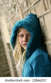 Beautiful young girl with blue sweater.