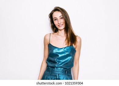 Beautiful young girl in blue t-shirt and riding breeches on a white background