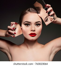 A beautiful young girl with bright makeup is holding two mirrors on a black background.Beauty, fashion, hairstyle, stylist, boutique, advertising, discounts, beauty salon, magazine.
