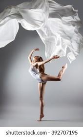 beautiful young girl dancing. Flowing fabric. Girl throws up the fabric. Fabric flies