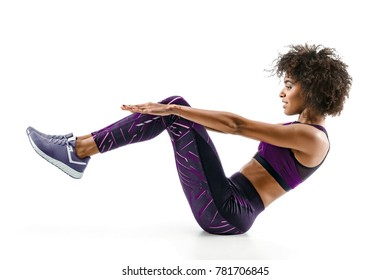 Beautiful young girl doing fitness exercise sit-ups, abs. Photo of african girl in silhouette on white background. Fitness and healthy lifestyle concept