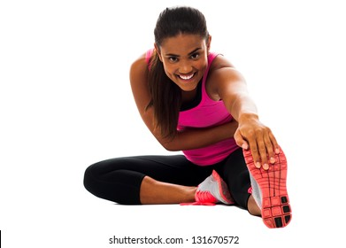 Beautiful young girl doing stretching exercise isolated on white.