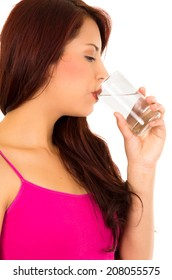 Beautiful young girl drinking water froma glass
