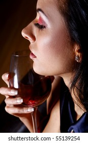 beautiful young girl drinkink wine
