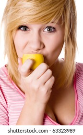 beautiful young girl eating lemon closeup on white background