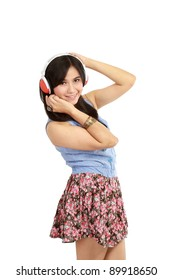beautiful young girl enjoys listening music. Isolated white background