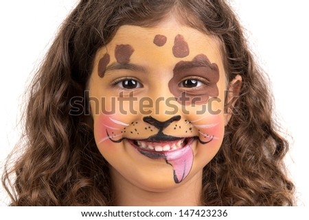 Beautiful young girl with face painted like a puppy