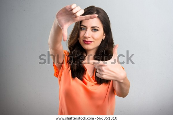 Beautiful Young Girl Focusing Her Fingers Stock Photo Edit Now