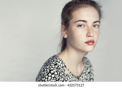 beautiful young girl with freckles