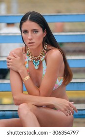 Beautiful young girl with Gold Flash Tattoo jewelry on the skin
