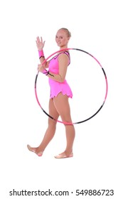 Beautiful young girl gymnast staying and waving with hoop over white background