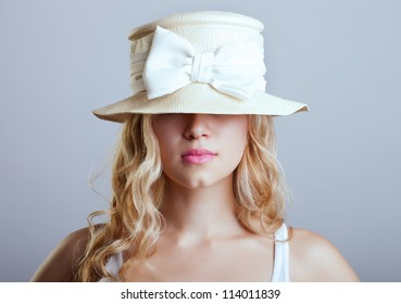 beautiful young girl in a hat
