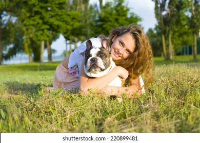 Beautiful young girl with her pet famous French Bulldog