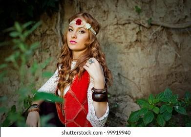 Beautiful young girl hippie posing outdoor