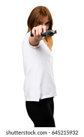 Beautiful young girl holding a pistol