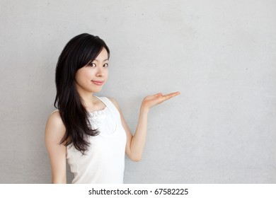 beautiful young girl introducing something