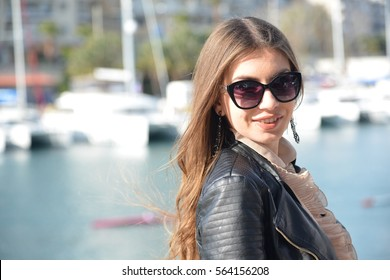 Beautiful young girl with large eye glasses  and long hair