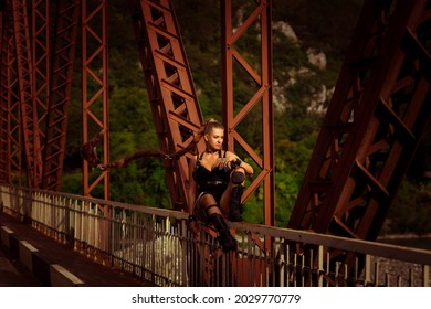 a beautiful young girl in leather clothes, in the style of Lara Croft, at a genre photo shoot