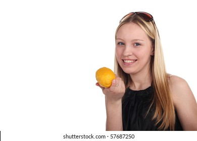beautiful young girl with a lemon in her hand