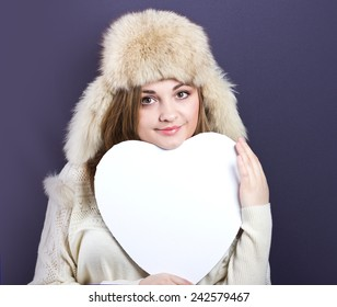 beautiful young girl in a light fur hat. Portrait of a girl with fair hair. Fur. fur hat