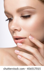 Beautiful young girl with a light natural make-up and French manicure. Beauty face.