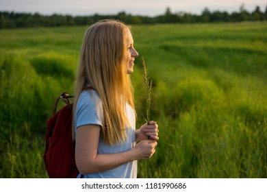Beautiful young girl with long hair in nature.