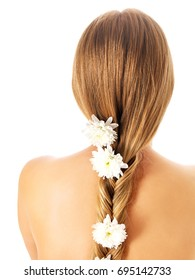 beautiful young girl with long hair with flowers in braid