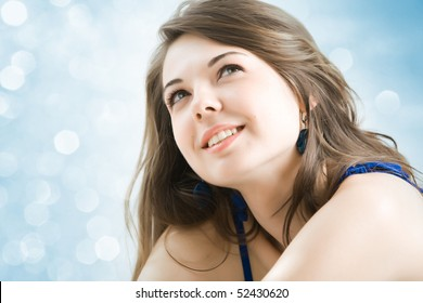 Beautiful young girl look up