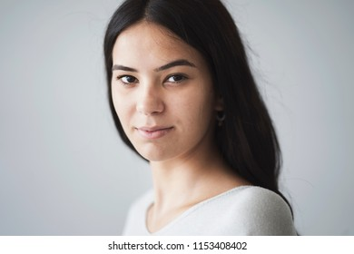 Beautiful young girl looking at camera portrait