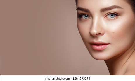 Beautiful young girl with natural nude make-up. Beauty face. Photo taken in studio