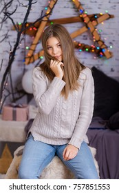 Beautiful young girl on the background of Christmas decorations