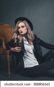 beautiful young girl on gray background with light ash violet hair with dark lips and black clothes