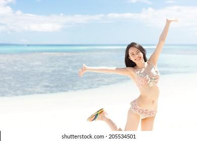 beautiful young girl on tropical island beach