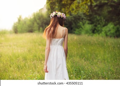 beautiful young girl in the park at sunset